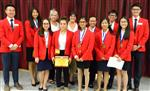 Photo of 11 high school students in red jackets