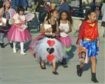 Photo of five elementary age girls wearing various storybook character costumes
