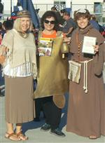 Thrree female teachers dressed as a Native American, Mission Bell, and Mission era priest