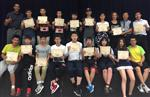 A large group of Chinese high school students holding certificates