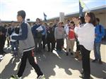 A Chinese student walks away after receiving a certificate from Ramona Junior High Principal Kathy Nash.