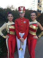 Three high school students in red and gold band uniforms