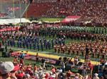 Photo of Magnolia Junior High Band performing next to USC Band on the field of a football stadium
