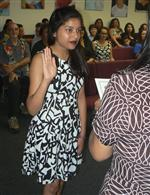 High school student Shweta Shah being sworn in at board meeting
