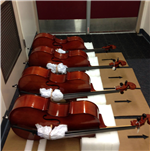 Photo of our cellos laying on their side