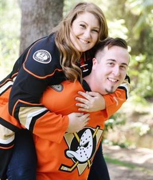 Mr. Edwards and his wife in Ducks' jerseys.