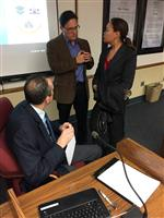 Photo of School Board member Andrew Cruz talking to Asst Superintendent Greg Stachura and Bond Counsel Ann Rohlin
