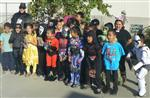 Elementary class and their male teacher wearing various storybook costumes