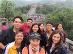 Photo of eight high school students and their teacher on the Great Wall of China