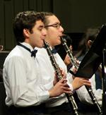 Photo of two high school boys in white shirts, playing the clarinet