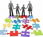 Illustration of a family of four in silhoutte, holding hands and preparing to walk down a multi-colored puzzle path