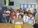 Group of students with box of hygiene items they donated