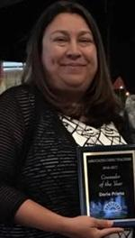 Head and shoulders photo of counselor Dorie Prieto, holding a plaque.
