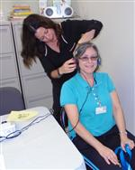 Woman having her hearing tested by another woman
