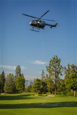 Photo of golf balls dropping from helicopter onto golf course