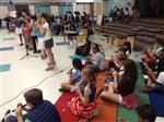 Photo of several elementary students playing the recorder in a school multi-purpose room
