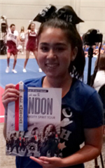 Head and shoulders photo of Natalie Duran, a Chino High cheerleader, holding a paper that says London