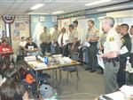 Sheriffs Department officers speaking to junior high students from the front of the classroom
