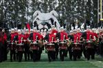 Photo of Ayala High Band drummers in front of a bulldog image